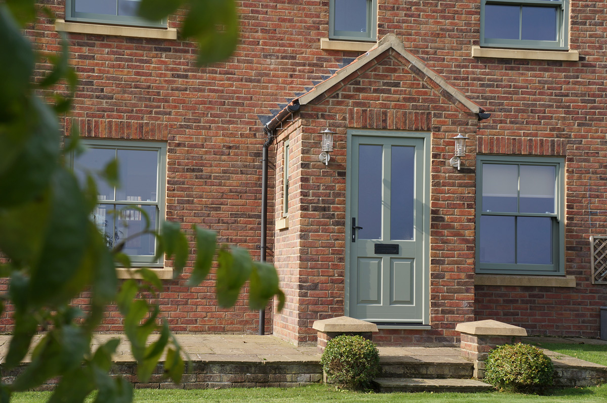 conventional box sash window small entrance door