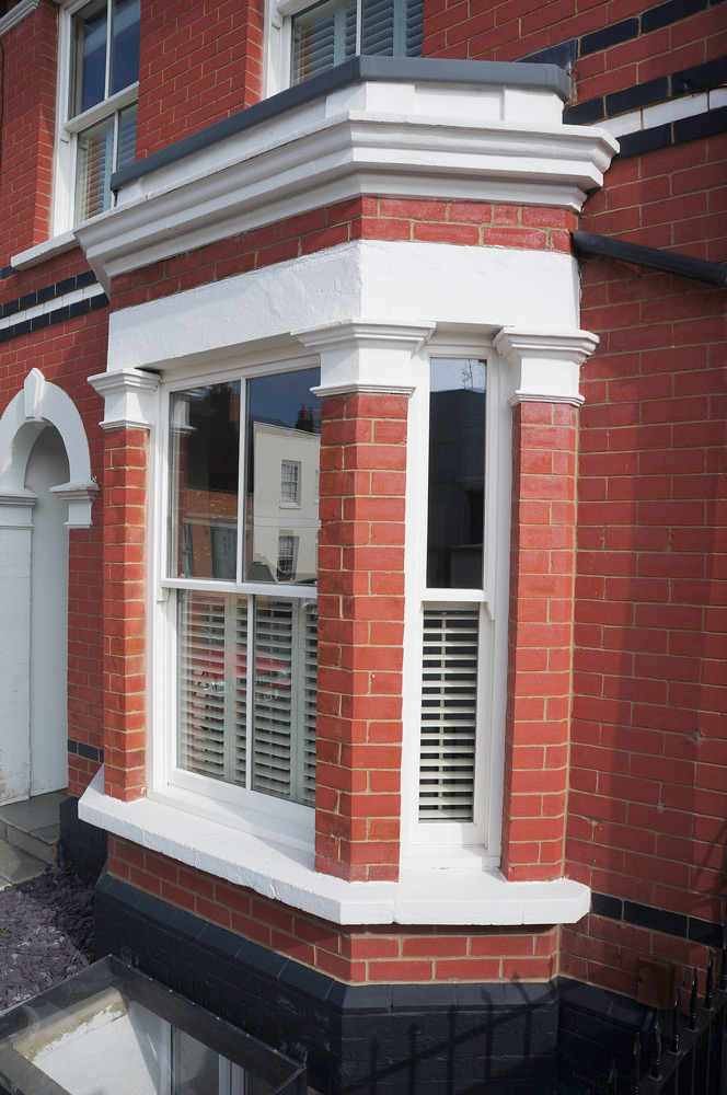conventional slim box sash bay window plantation shutters