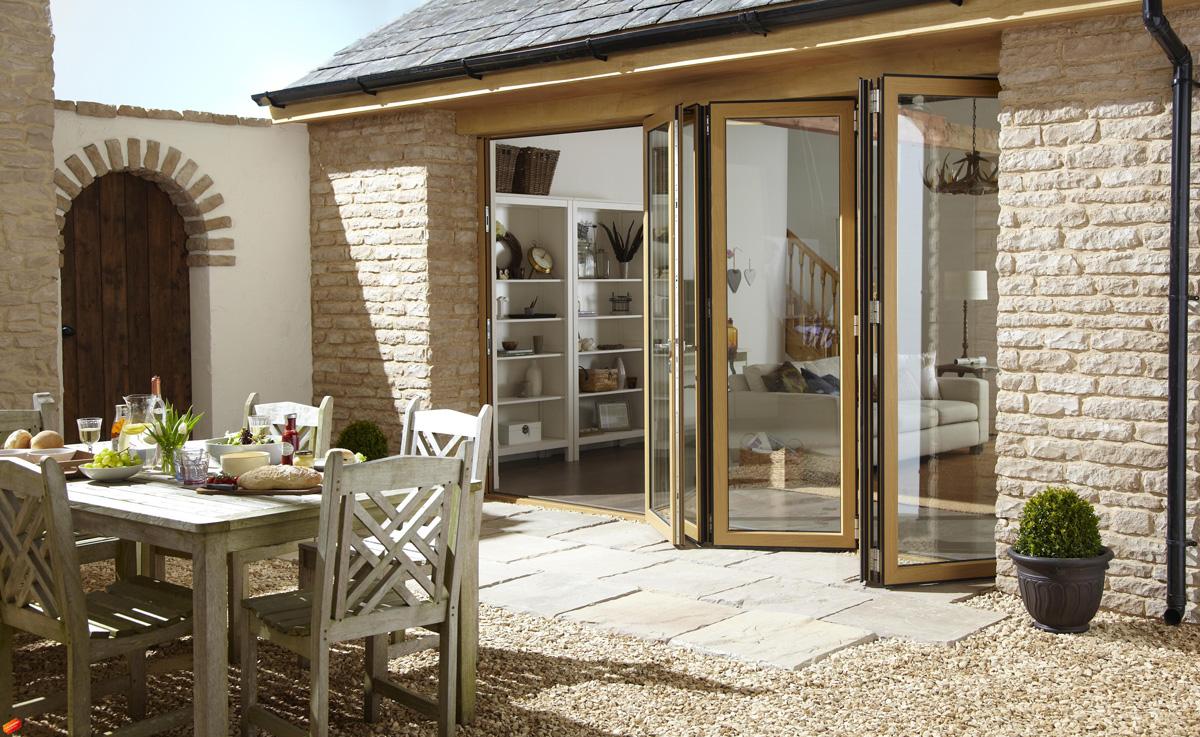 five panel aluminium bifold doors barn exterior