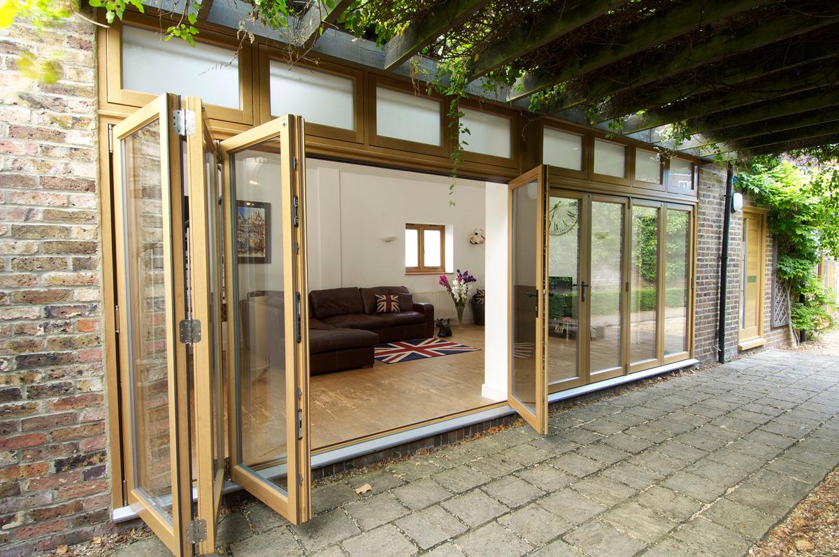 two bifold timber doors three panels side door exterior